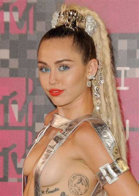 The Beauty Evolution of Miley Cyrus | StyleCaster