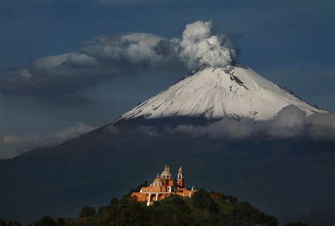The smoking peak of the volcano Popocatepetl in the sun ...