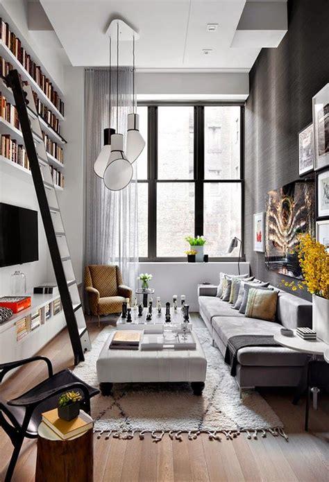 Un apartamento de doble altura en gris y amarillo · A grey ...
