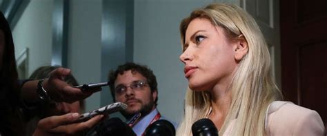 Wife of former Trump aide seeks to end speculation that ...