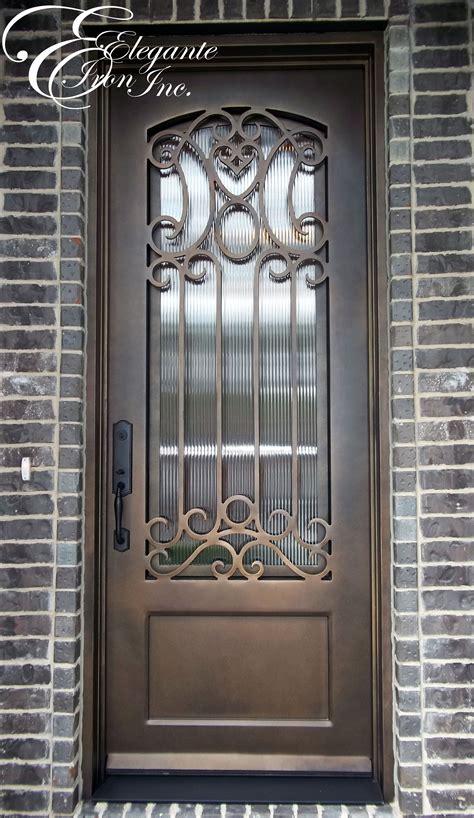 Wrought iron door with eyebrow arch grille. | Single doors ...