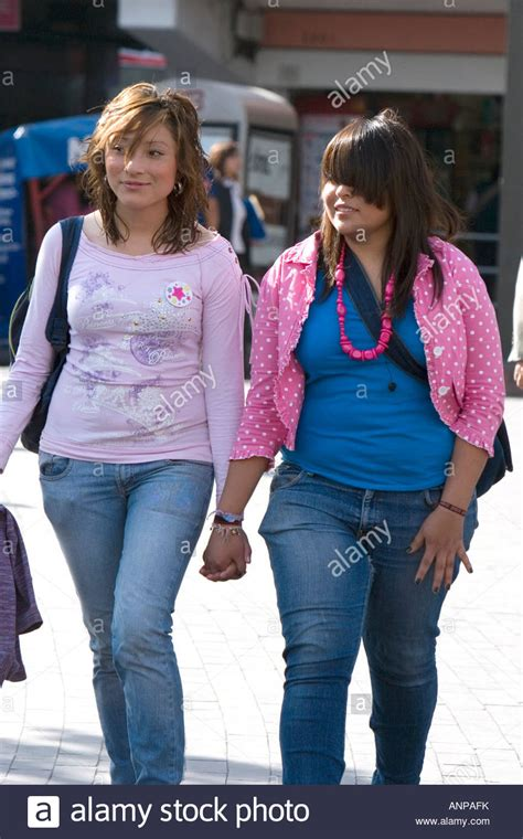 Young Mexican women holding hands at Insurgentes Plaza in ...